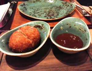 Scotch egg on a trencher - sans serving spoons.